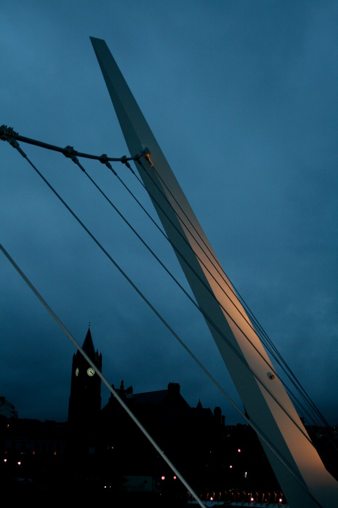 iconic spire of peace bridge reaching up with guild hall in background