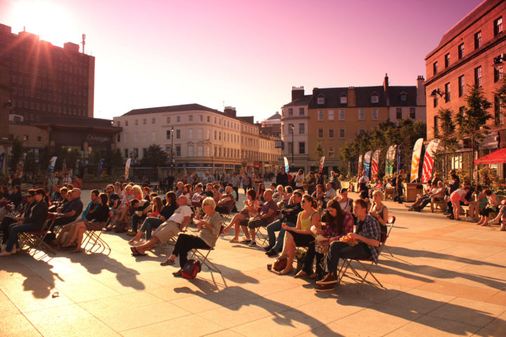 Crowd of people sitting in Dundee's City Square