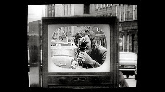 David Hall, TV Interruptions, still from TV shoot-out piece, 1971.
