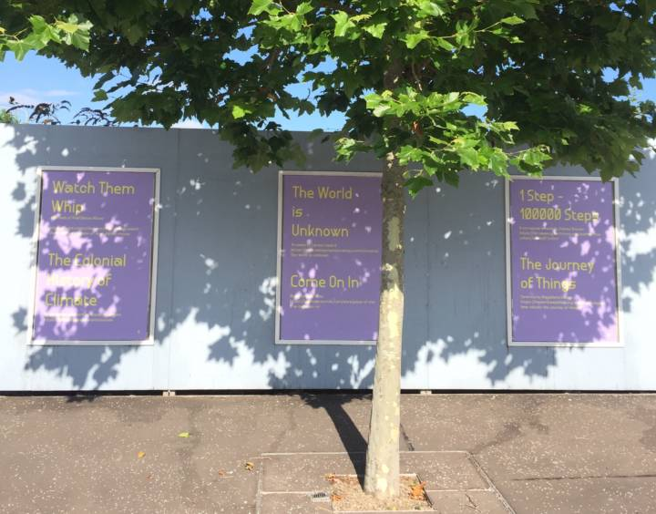 a photohgraph of hoarding boards with large posters featuring text based work by Claire Yspol