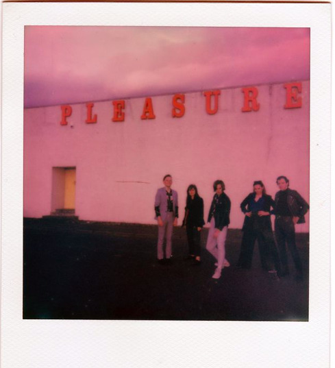 a polaroid picture of The five band members of Echom Machine , standing outside pleasureland in Arbroath